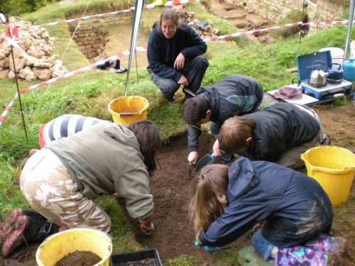 YAC members digging a test pit